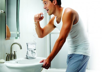 Man Using the Aquarius Waterpik