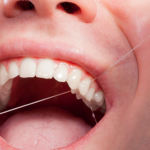 Flossing every day can reduce gum disease
