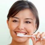 woman brushing teeth white toothbrush