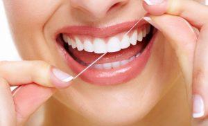 Get rid of stains between teeth with regular flossing