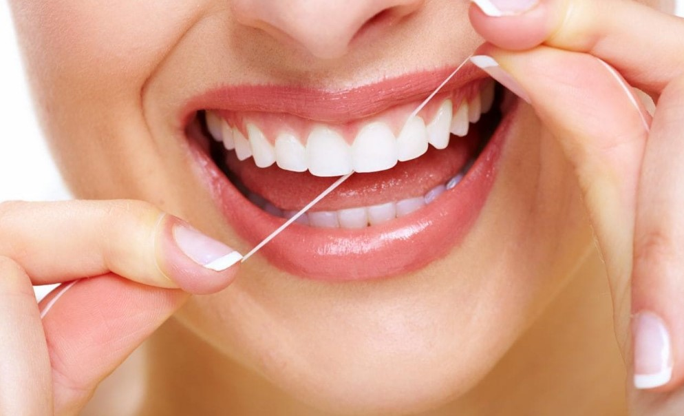 proper oral maintenance includes teeth flossing