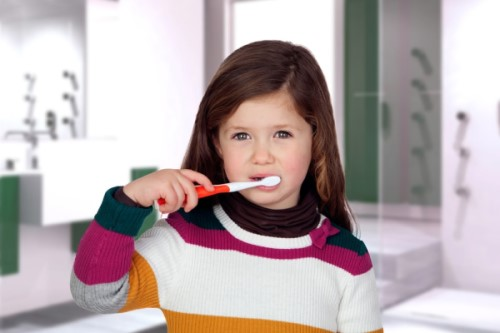 when should a child brush their own teeth