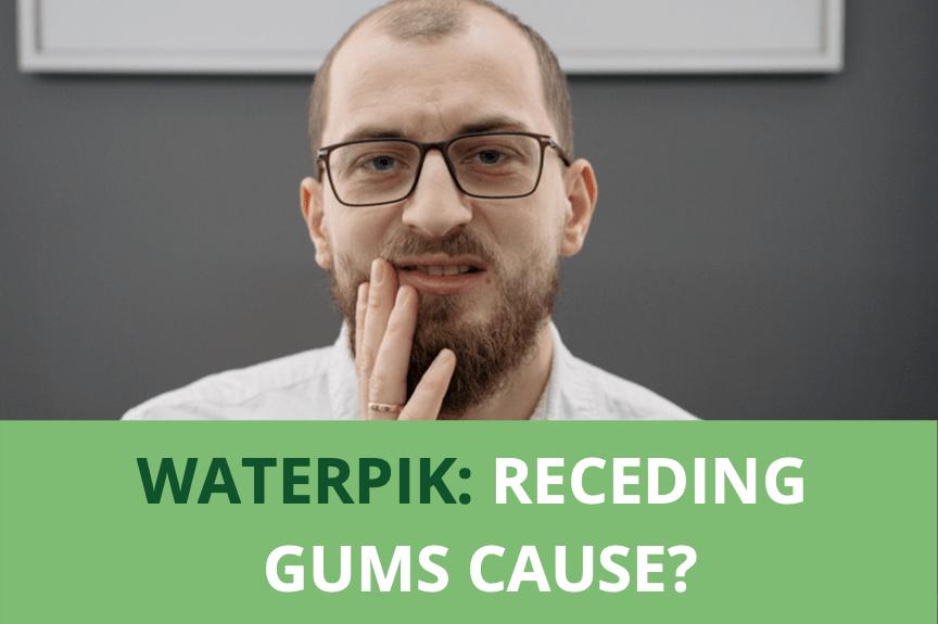 man touching his mouth wearing eyeglass, receding gums cause