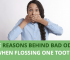 Woman or Girl covering her mouth with both hands, reason behind bad odor when flossing